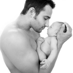 man_with_baby_black_white